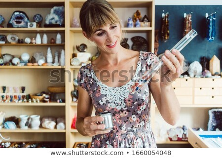 Woman working with different kinds of gemstones Stock photo © Kzenon