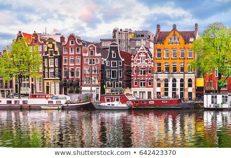 канал · Амстердам · тюльпаны · Нидерланды · небе · воды - Сток-фото © anna_om
