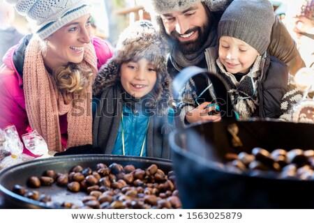 Aile yeme tatlı gıda Noel pazar Stok fotoğraf © Kzenon