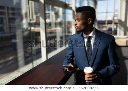мнение молодые бизнесмен чашку кофе Сток-фото © wavebreak_media