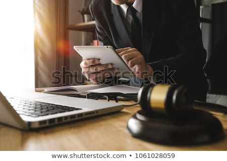 Stock photo: Justice and law concept, Male judge in a courtroom striking the