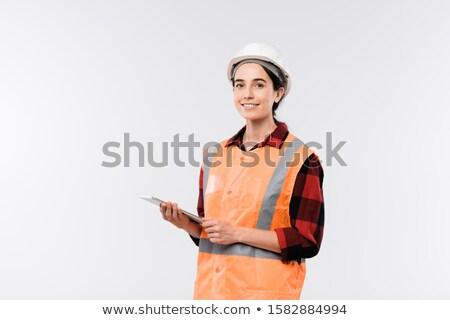 Jóvenes alegre femenino ingeniero casco naranja Foto stock © pressmaster
