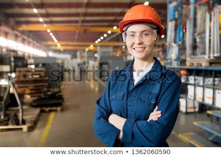 Mooie ingenieur Blauw werkkleding bril helm Stockfoto © pressmaster