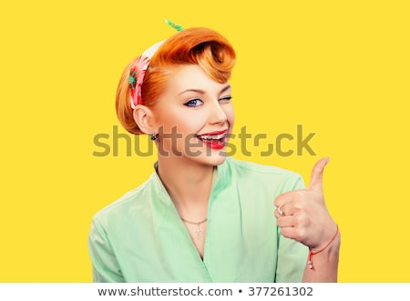 Pretty young smiling businesswoman in shirt looking at you in isolation Stock photo © pressmaster