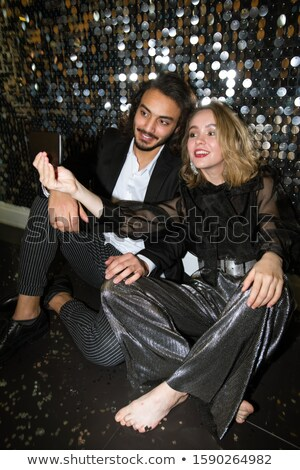 Happy well-dressed dates making selfie while sitting on the floor in night club Stock photo © pressmaster