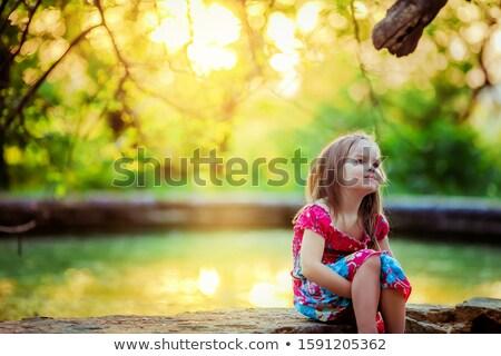 Piękna dziecko dziewczyna rok starych posiedzenia Zdjęcia stock © ElenaBatkova