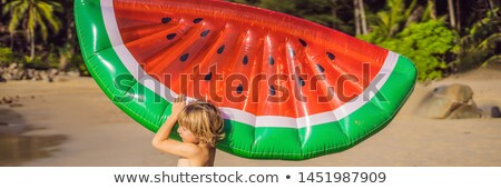 The boy goes to sea with an inflatable mattress BANNER, LONG FORMAT Stock photo © galitskaya