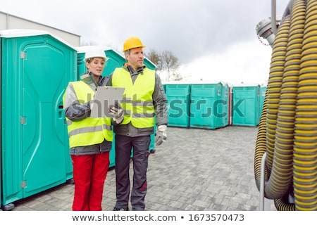 Workers inspecting mobile toilet before shipment Stock photo © Kzenon