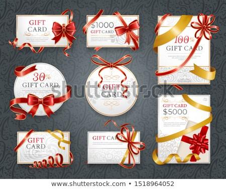 Carte-cadeau décoré ruban arc tourbillon brochure Photo stock © robuart