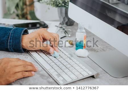 man disinfecting a computer keyboard Stock photo © nito