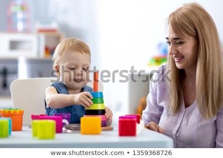 Small baby with a toy pyramid Stock photo © karandaev