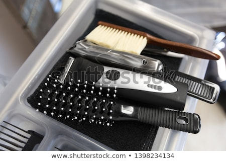 brushes, trimmers and comb on tray at hair salon Stock photo © dolgachov