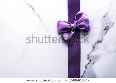 Fioletowy jedwabiu wstążka łuk luksusowe marmuru Zdjęcia stock © Anneleven