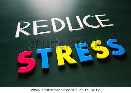 túlhajszolt · fotó · nő · asztal · fehér · stressz - stock fotó © ansonstock