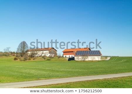 Farming land with buildings on a green fields and areas, Austria. Stock photo © artjazz