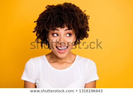 Image of multinational women expressing surprise and looking aside Stock photo © deandrobot