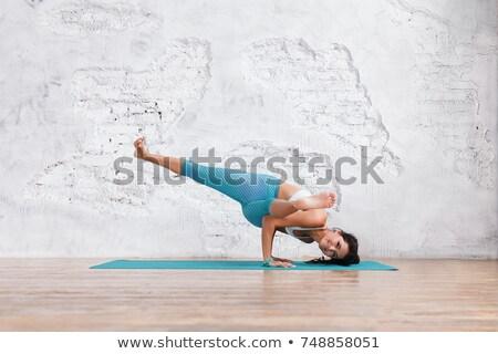 Woman Practicing Sage Pose Yoga Exercise Stock photo © rognar