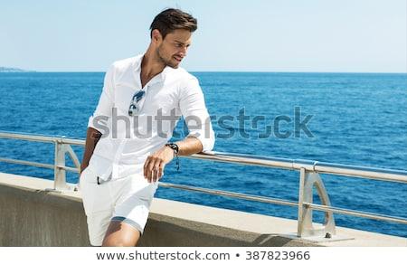 Moda morza młodych pani stałego skał Zdjęcia stock © mtoome