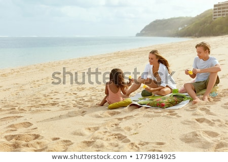 Family portrait on sandy coast Stock photo © Paha_L