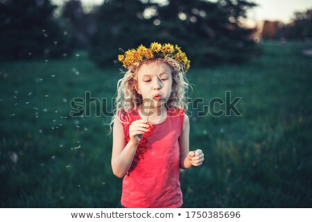girl in a chaplet from dandelions Stock photo © Artspace