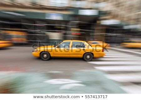 Taxi cab speeding down street in a blur Stock photo © Balefire9