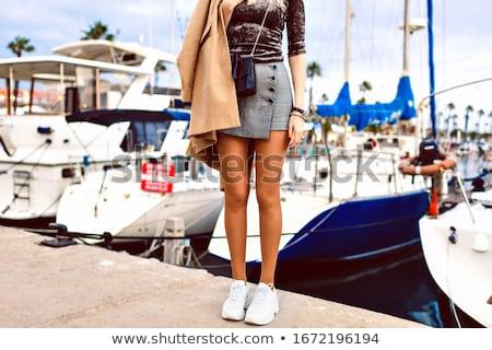 gyönyörű · szőke · nő · fekete · miniszoknya · divat - stock fotó © rob_stark