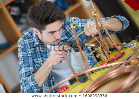 Plumber using blow-torch to heat pipe Stock photo © photography33