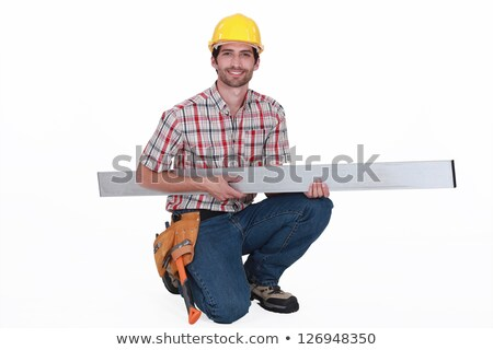 Tradesman carrying a girder Stock photo © photography33