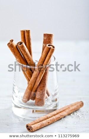 cinnamon sticks stacked vertical stock photo © calvste