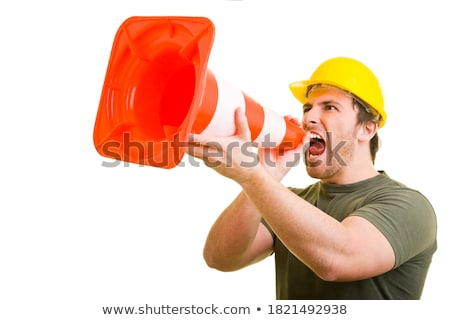 Laborer shouting into traffic cone Stock photo © photography33