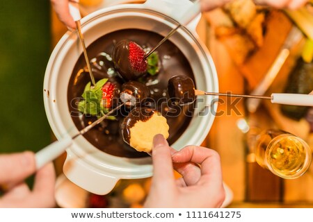 Fondue with friends Stock photo © photography33