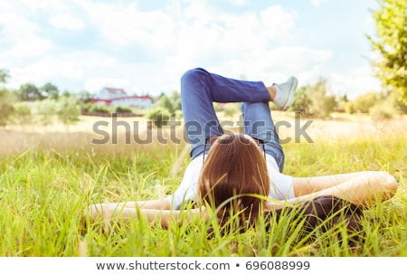 teen girl lying in grass stock photo © andreykr