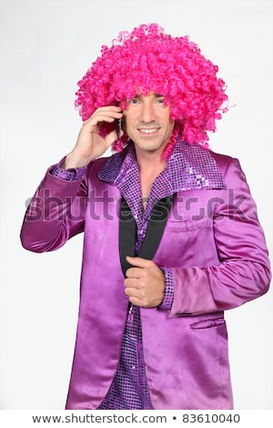 Man in Seventies costume and crazy wig on cellphone Stock photo © photography33
