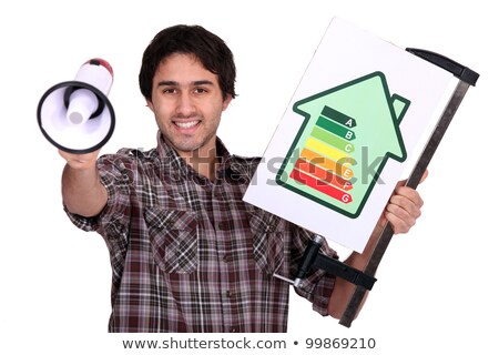 Man holding megaphone and electrical efficiency banner Stock photo © photography33