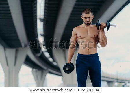 Puissant musculaire torse nu homme poids Photo stock © feedough