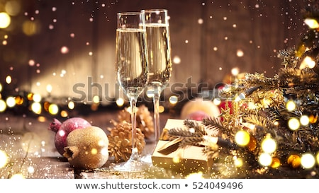 Two champagne glasses on the dinner table Stock photo © Melpomene
