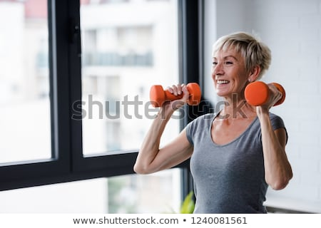 woman lifting weights at home stock photo © photography33