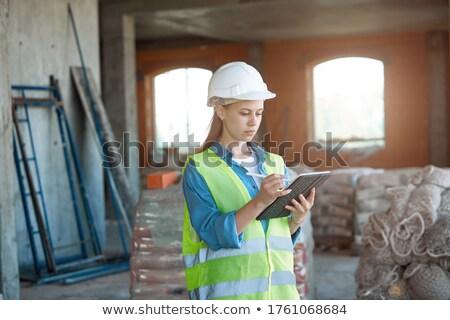 bouwer · architect · bespreken · plannen · gebouw · schoonheid - stockfoto © photography33