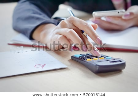 Calculator and pencil on the calendar stock photo © Bellastera