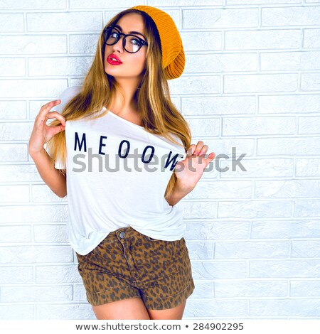 Happy red-haired girl in a t-shirt and shorts stock photo © acidgrey