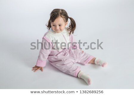 Attractive blonde in a nightie barefoot Stock photo © acidgrey