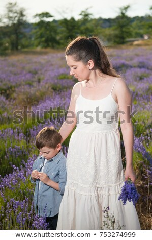 happy child holding lavender stock photo © yaruta