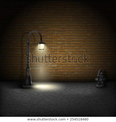 brick wall and street lantern stock photo © stevanovicigor