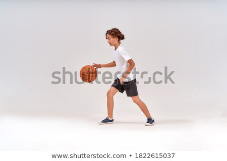 Little kid while throwing the basketball Stock photo © get4net