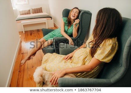 beautiful woman enjoys pregnancy laughing smiling bedroom sittin stock photo © cboswell