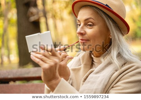 mooie · jonge · vrouw · lipgloss · witte · glimlach - stockfoto © lighthunter