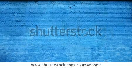 old blue wall background stock photo © claudiodivizia