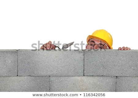 Stonemason peering over a low wall Stock photo © photography33