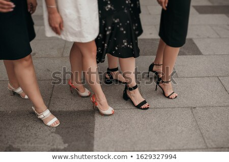 four fashionable girls with their shoes stock photo © andreypopov