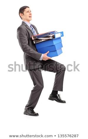 jóvenes · empresario · libros · hombre · de · negocios · sonrisa - foto stock © Cursedsenses